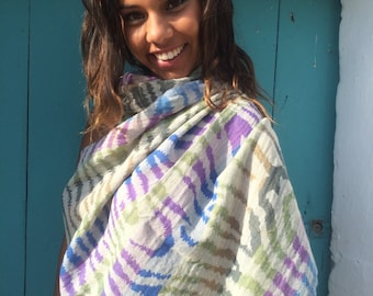 Cosy merino wool shawl in blue green animal print