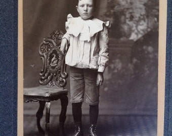 A Poignant Portrait // Original identified antique cabinet card of pale boy with outrageous ruffle collar  // Unique Victorian boy photo
