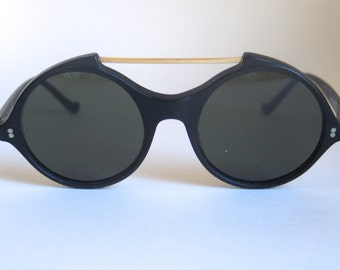 Versace vintage sunglasses made in the 80's in Italy. Rare and collectible.