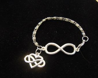 Silver Tone Infinity Charm Bracelet With A Heart Infinity Charm