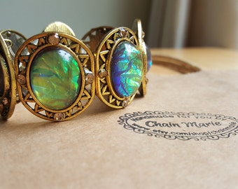 Gold bracelet with green/blue pendants