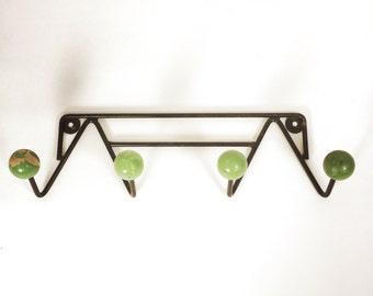 Coat rack made of wood and metal.