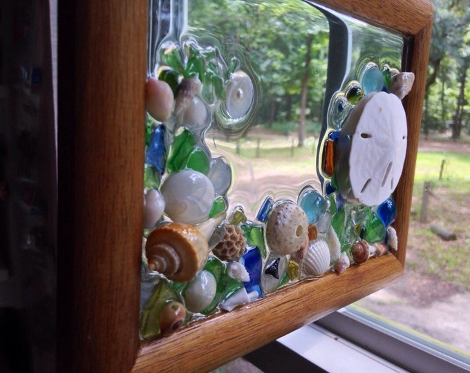 Seashell Suncatcher • A Sand Dollar with a Wave of Seashells, a Sea Urchin, Sea Glass and Teal Beads • Window Art • Crafts by the Sea