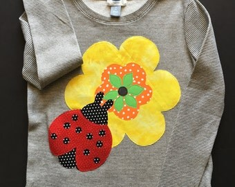 Girl's T-Shirt Size 8, Long Sleeve, Light Weight gray and white tee with flower and ladybug appliques