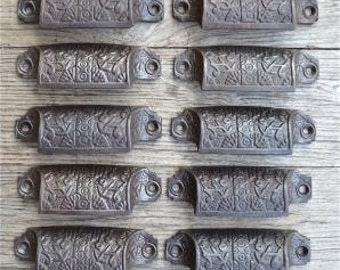 A set of 10 Eastlake style cast iron drawer pulls AL17