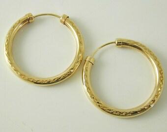 Hoop earrings faceted design 9 carat gold 28.3mm 1.9 grams
