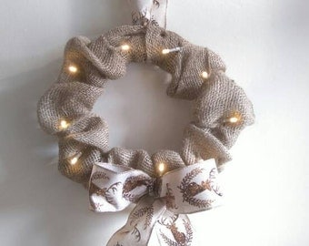 Hessian bow with stags bow detail with fairy lights