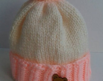 Baby preemie knitted pom pom hat pink and cream