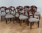 Antique English Victorian Set of 12 Twelve Mahogany Carved Back Upholstered Dining Chairs Attributable to James Shoolbred  Co. (Circa 1880)