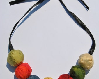 Elegant multicolor statement necklace composed of shantung silk spheres  and satin ribbon