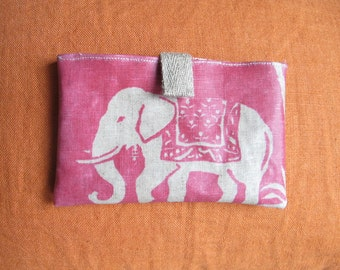 "Pocket for cell phone or cards in linen coated ""pink mandir""."