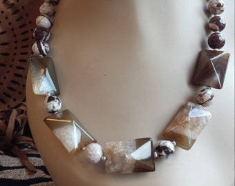 One strand beaded necklace made with faceted jasper and pyramid onyx