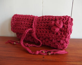 Clutch crochet from t shirt  yarn in the color dark red.