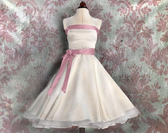 Lovely wedding dress with rose tapes