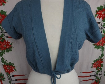 Vintage 1950's 1960's knit sweater, almost a vest, that ties in the front!