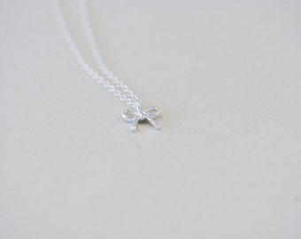 Dainty necklace with bow pendant of sterling silver