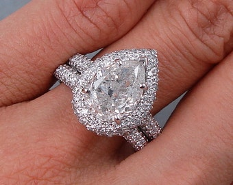 Beautiful 5.02 ctw Pear Shape Diamond Engagement Ring with a 3.18 G Color/SI3-I1 Clarity Enhanced Center Diamond