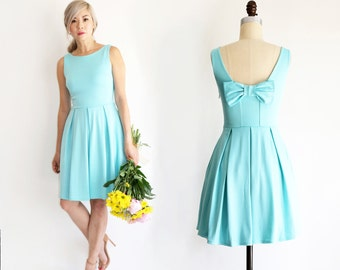 JANUARY | Aqua - seafoam teal bridesmaid dress with back bow detail. Summer aqua mint party dress with pleated skirt and pockets