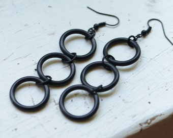 Long black rubber earrings