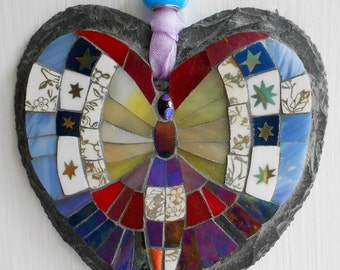 Mosaic butterfly on a slate heart