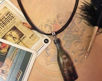 Creepy Dolls - Vintage bottle necklace made from acrylic, on black and brown leather.