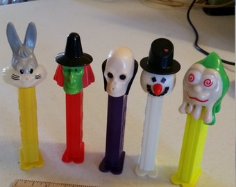 5 vintage pez holder dispensers - skull - witch - snowman - bugs bunny - monster - collectibles candy foreign made toys