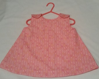 Girls pink swing top.