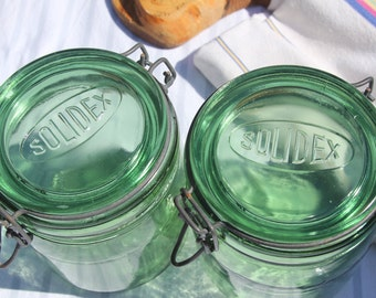 A matched pair of vintage French 1930's/40 Soldex Green glass preserving jars
