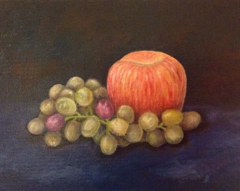 An apple and grapes