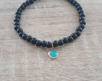 Pretty bracelet with turquoise glass pendant
