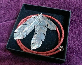 Silver feather pendant - three feathers