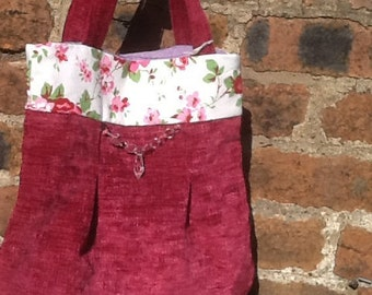 Sumptuous pink tote bag with flowery trim and clear faux crystal beads