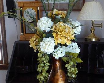 Bronze vase arrangement, Silk Hydrangea, Golden yellow and Creamy white floral arrangement