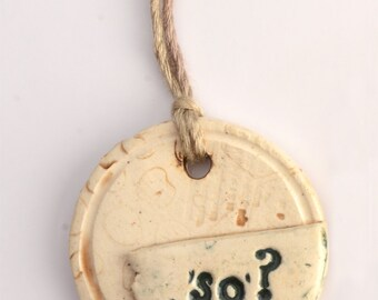 small ceramic pendant necklace stamped with so