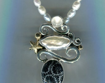 Fossilized coral with baroque pearl. this is joys beach comber pendant with sterling silver and 14kt solid gold trim