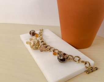 Golden Bauble Charm Bracelet - Classic gold toned chain bracelet with glass beads