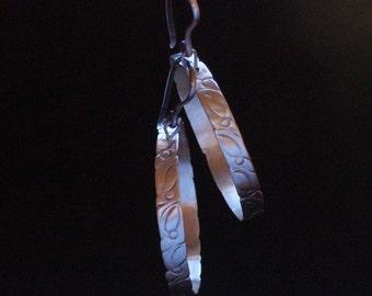 Large Sterling hoop earrings , hand tooled , sophisticated ,oval hoops