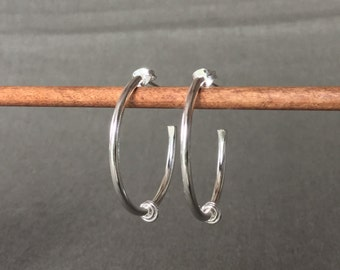 Silver hoops with triple rings