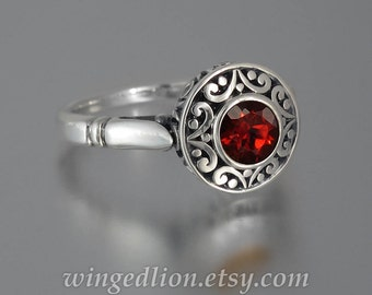 The SECRET DELIGHT silver ring with red Garnet and white sapphires
