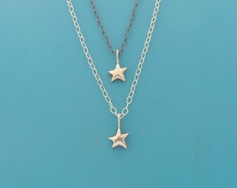 Teeny tiny sterling silver leaping star