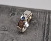 Reserved for Lynne - 1/4 inch wide textured sterling silver spinner ring with 3mm round blue sapphire