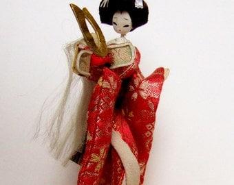 Vintage Japanese Doll - Geisha in Kimono Holding Kabuto Samurai Helmet