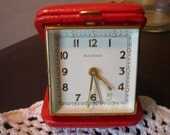 Vintage Bucherer 17 Jewel manual travel alarm clock with red leather clamshell case square face- restored and working great -  1970s