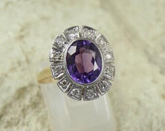 14k yellow gold purple sapphire diamond ring.