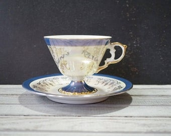Blue Iridescent Tea Cup and Saucer with Couple