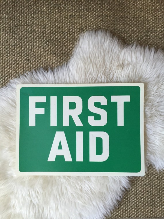 vintage green retro plastic first aid wall sign