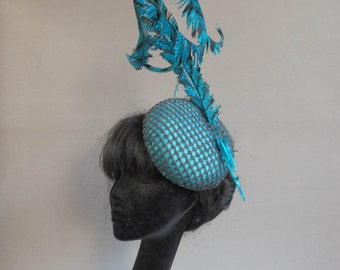 Duth design aqua sinamay hat covered with black lace and topped of with ton sur ton pheasant feathers on comb