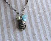 Owl necklace - owl charm on antique bronze chain with pearl & blue flower - nature, wise, forest, bird