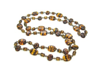 Glass Beaded Necklace. Czech Oval Brown & Amber Beads. Tortoiseshell, Tiger Stripe.  Gilt Filigree. 36 in Long. Vintage 1950s 60s Jewelry.