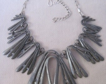 Bold Contemporary Graduated Fan Leaves in a Silver Grey Gun Metal Necklace